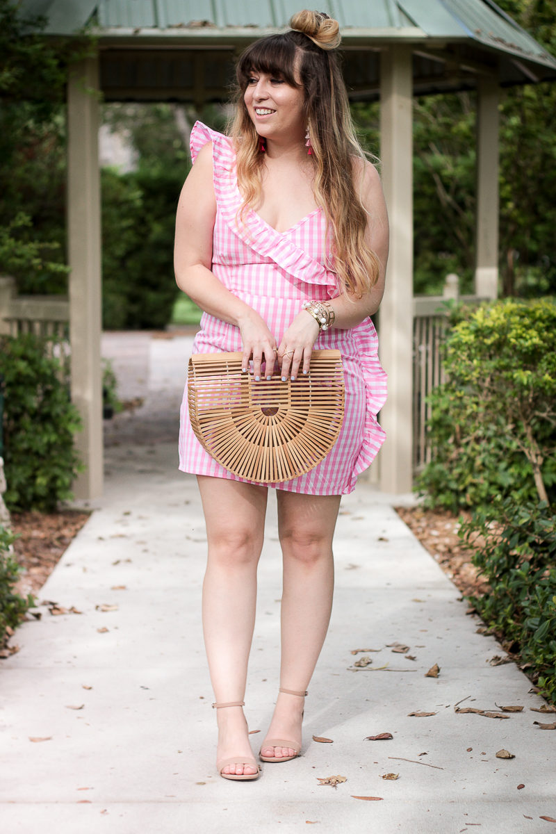 Miami fashion blogger Stephanie Pernas wearing a pink ruffle gingham dress and block heel sandals
