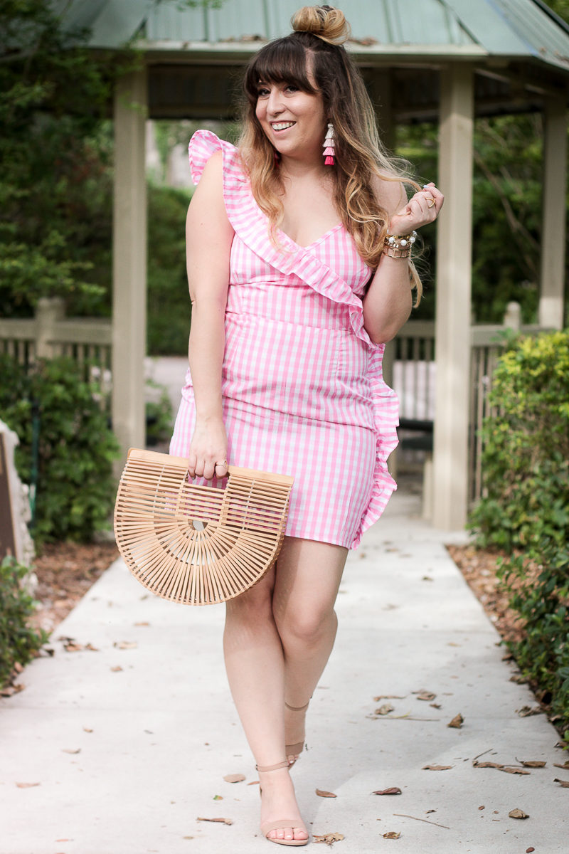 Miami fashion blogger Stephanie Pernas of A Sparkle Factor wearing a pink ruffle gingham dress for summer