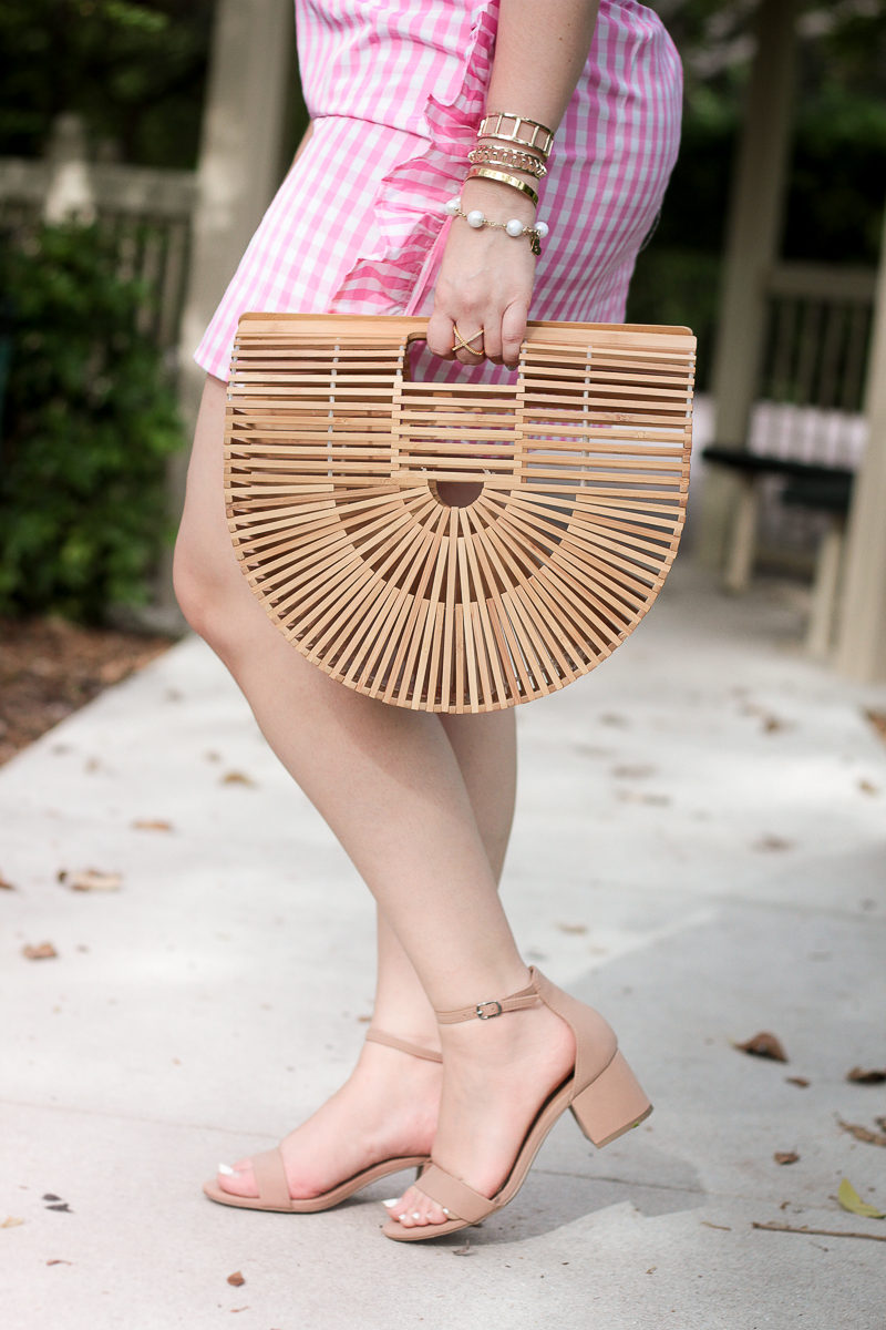 Miami fashion blogger Stephanie Pernas styles a Cult Gaia dupe bag from Zoe & Grace