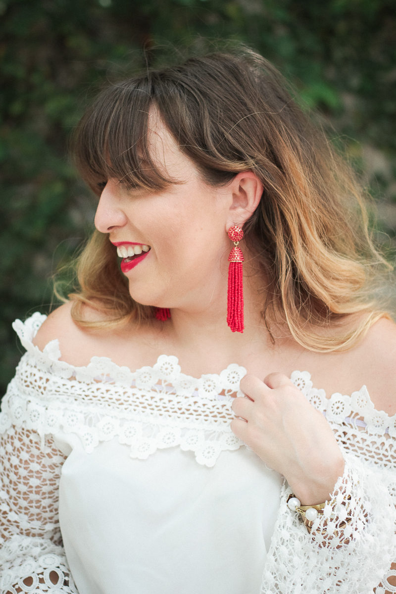 Miami fashion blogger Stephanie Pernas wearing red tassel earrings