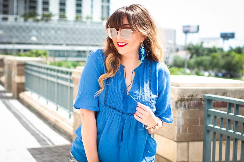 Fashion blogger Stephanie Pernas wearing Baublebar Rosalita Tassel earrings