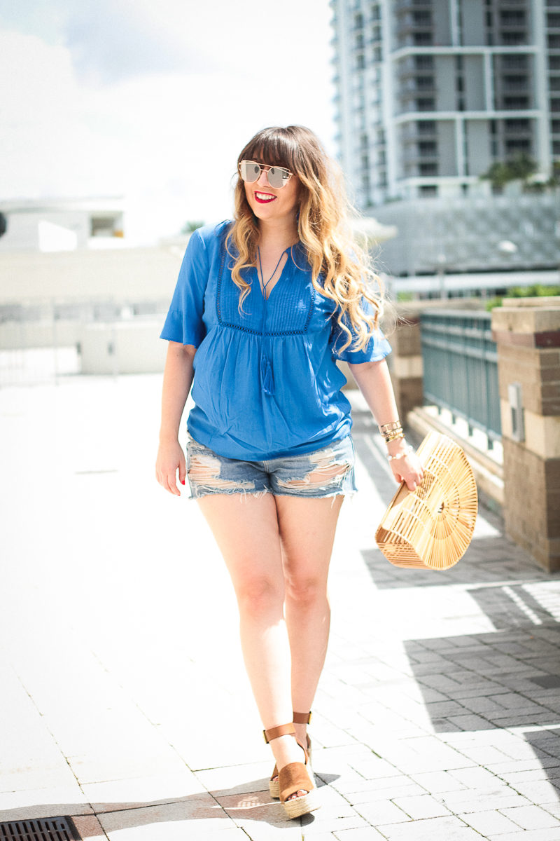 Miami fashion blogger Stephanie Pernas styles a swing top and jean shorts outfit
