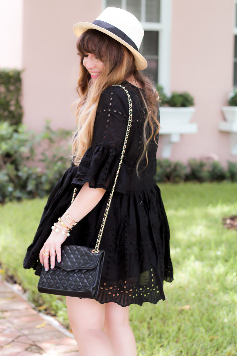 Miami fashion blogger Stephanie Pernas wearing a Shein black eyelet babydoll dress and J.Crew Panama hat