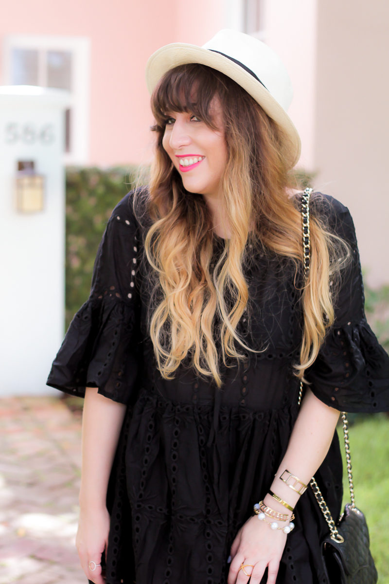 Miami fashion blogger Stephanie Pernas wearing a black eyelet dress for summer
