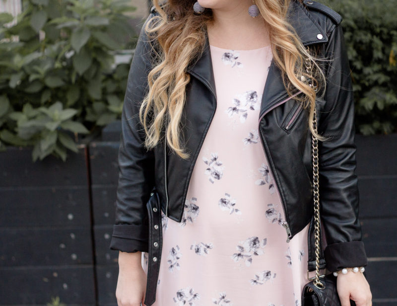 Miami fashion blogger Stephanie Pernas wearing a leather jacket and floral dress