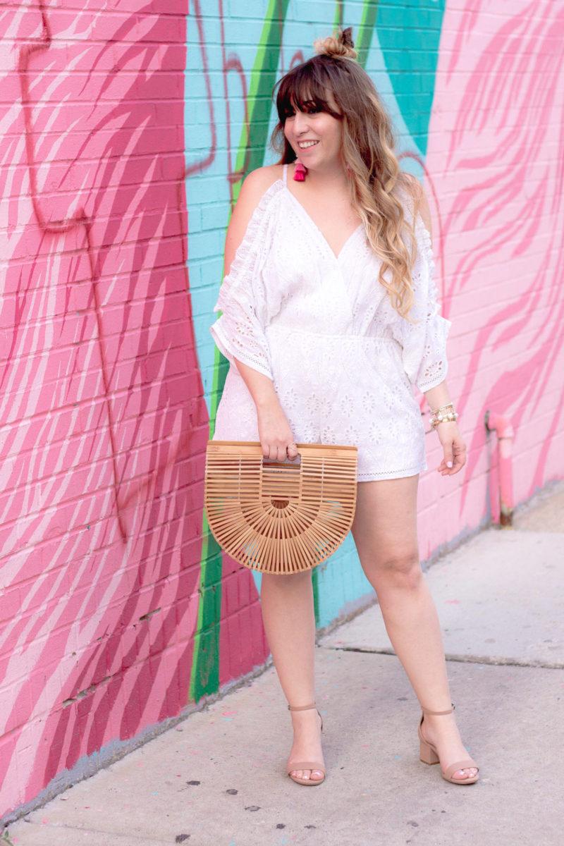 Miami fashion blogger Stephanie Pernas styles an eyelet romper and tassel earrings for summer