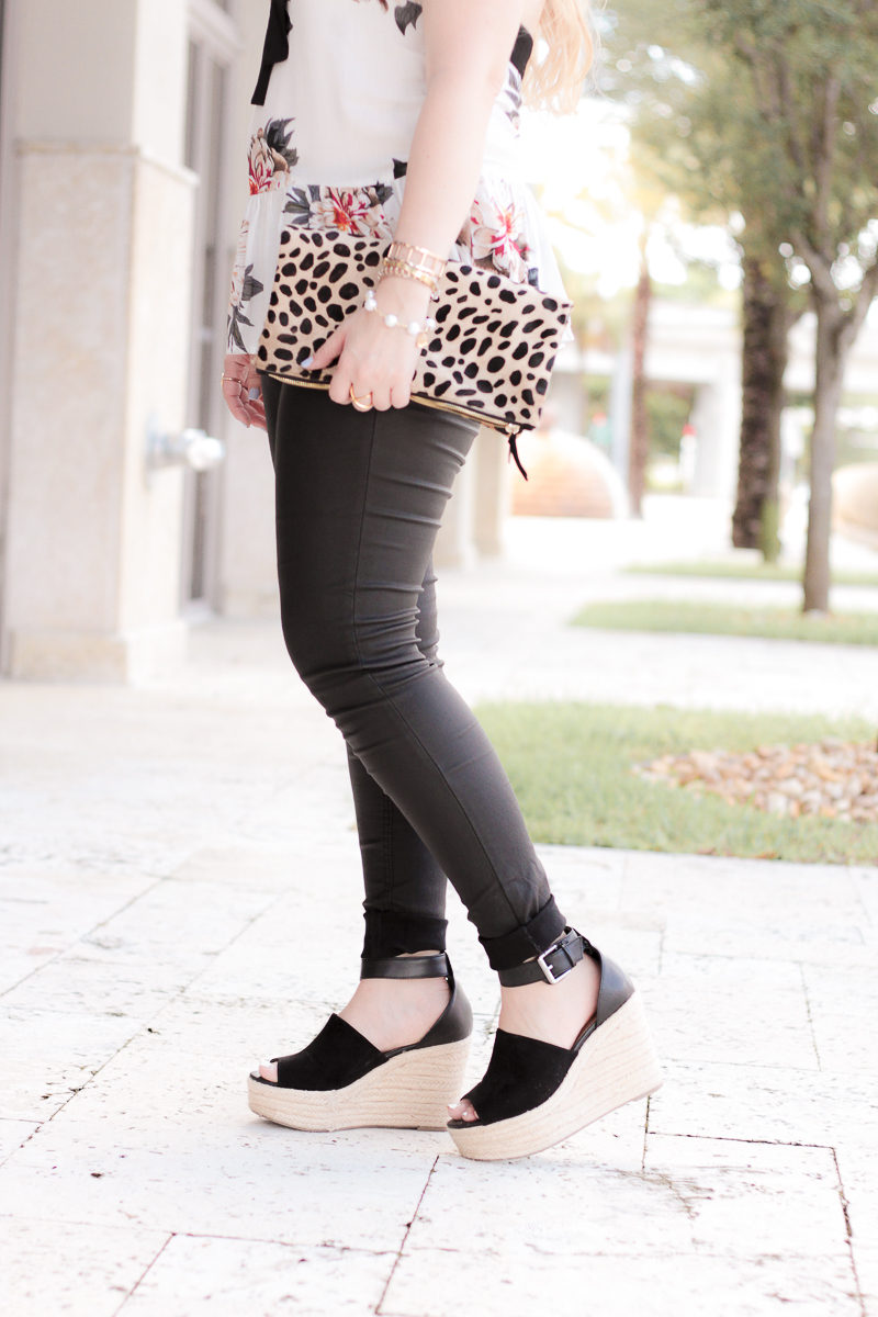Miami fashion blogger Stephanie Pernas wearing coated jeans and wedges