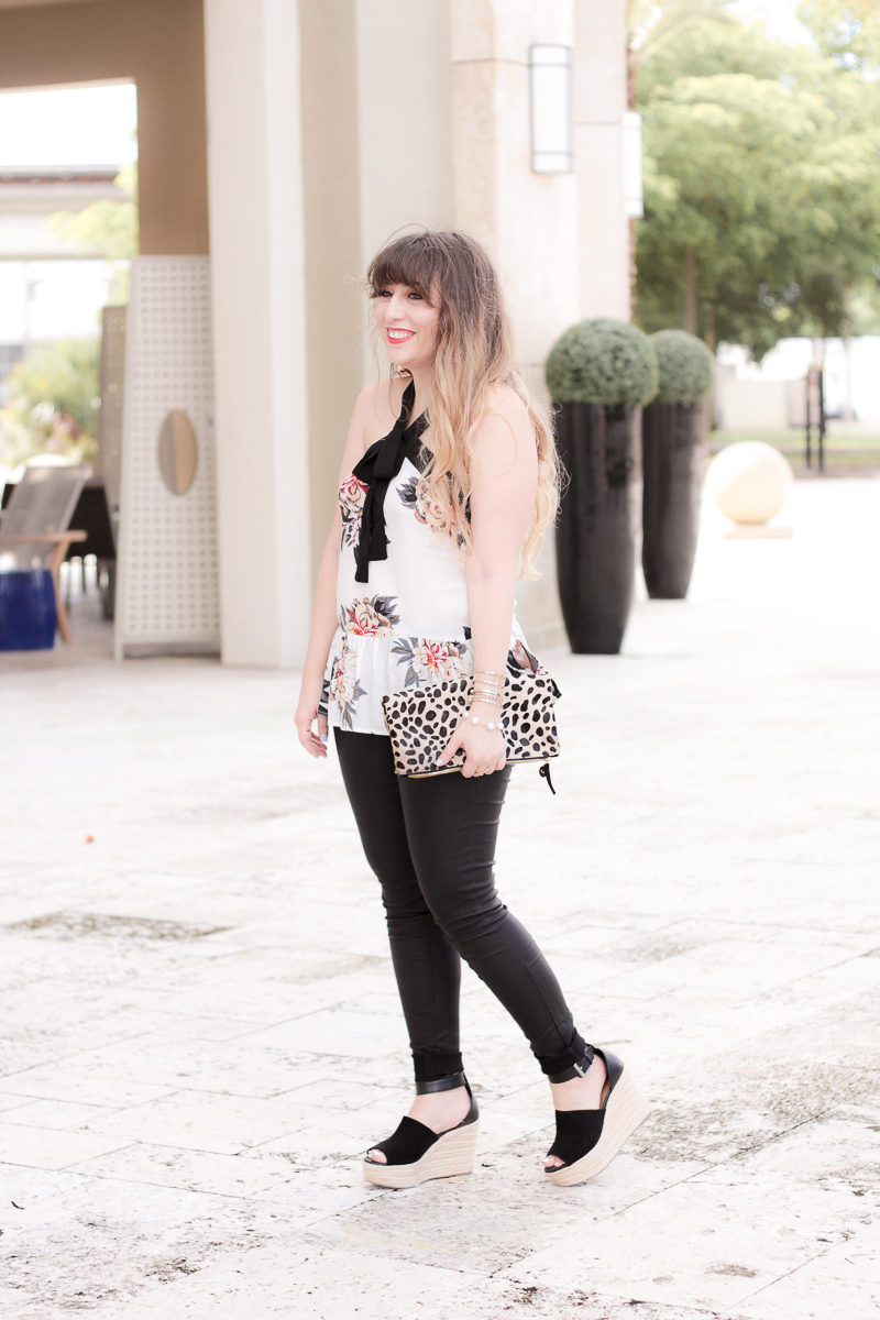 Miami fashion blogger Stephanie Pernas wearing coated jeans and a cute peplum top