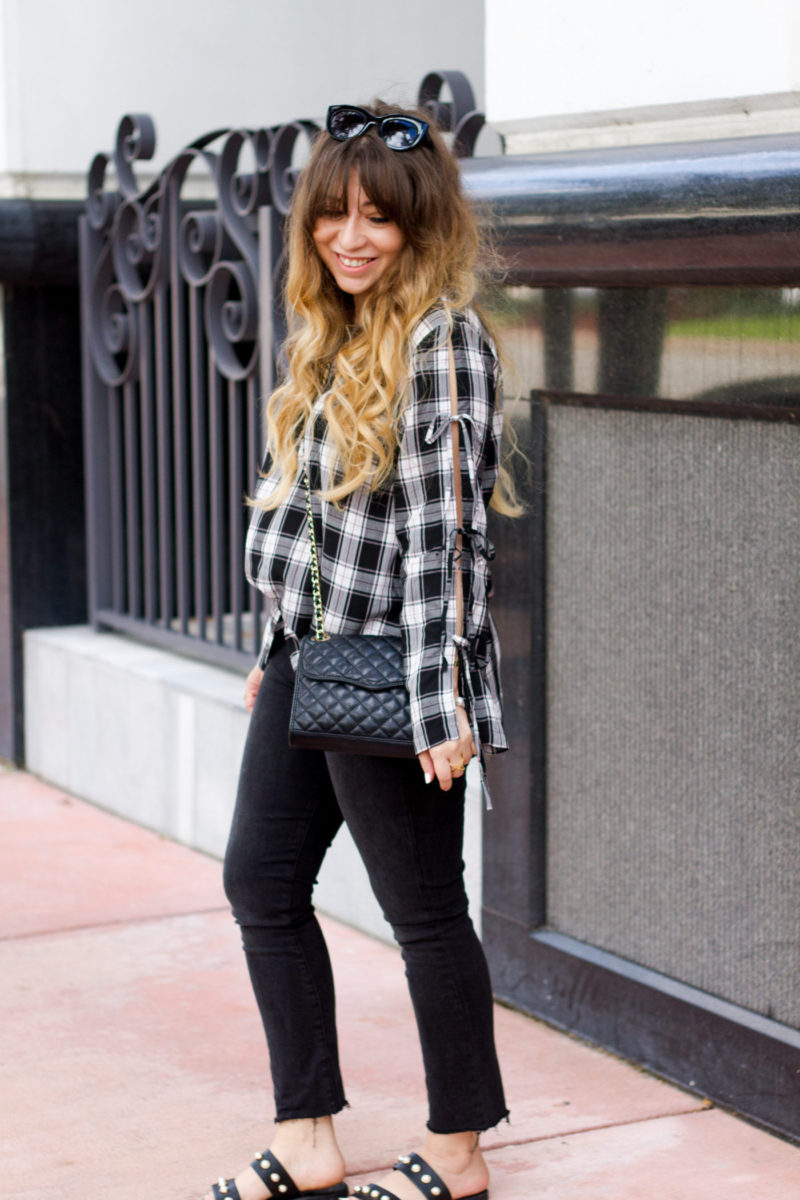 Miami fashion blogger Stephanie Pernas styles cropped jeans and a plaid top for fall