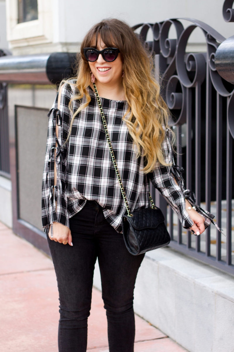 Miami fashion blogger Stephanie Pernas wearing a black plaid top and skinny jeans