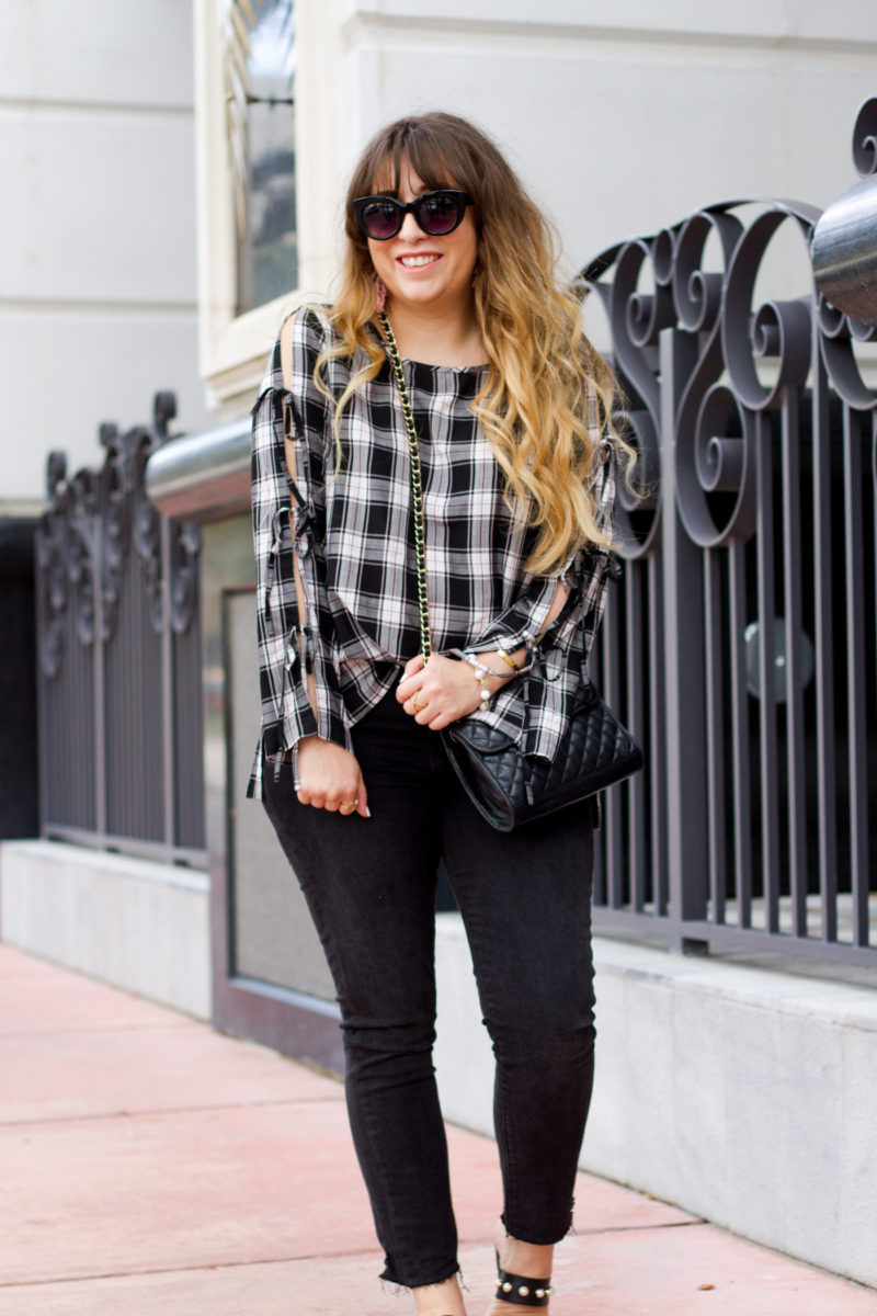 Miami fashion blogger Stephanie Pernas wearing a LOFT top and jeans