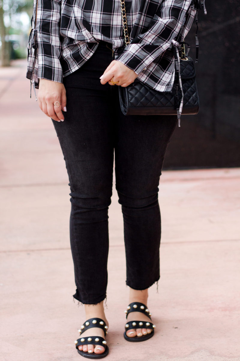 Miami fashion blogger Stephanie Pernas styles a plaid top and jeans for fall