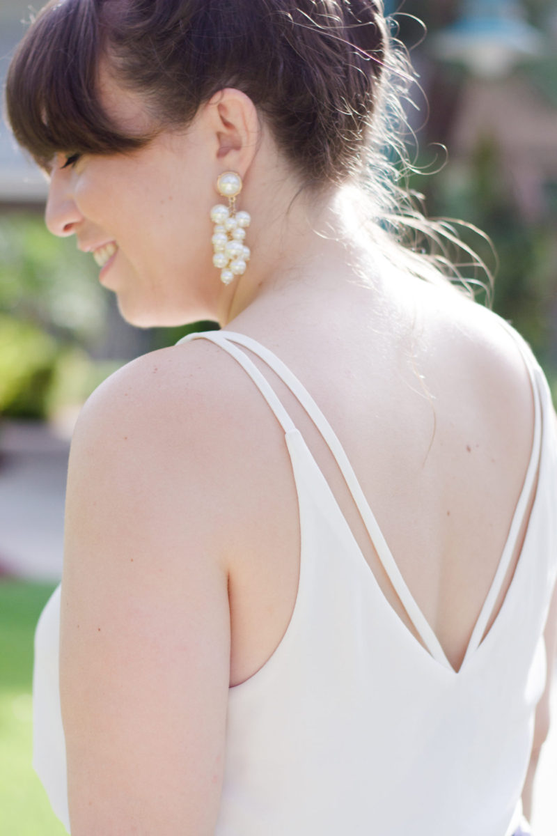 Miami style blogger Stephanie Pernas wearing Baublebar pearl cluster earrings and a Topshop camisole
