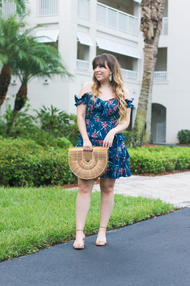 Miami fashion blogger Stephanie Pernas of A Sparkle Factor wearing a Wayf floral off the shoulder dress