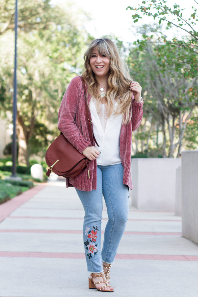 Miami fashion blogger Stephanie Pernas of A Sparkle Factor wearing a chenille cardigan and floral jeans outfit for fall