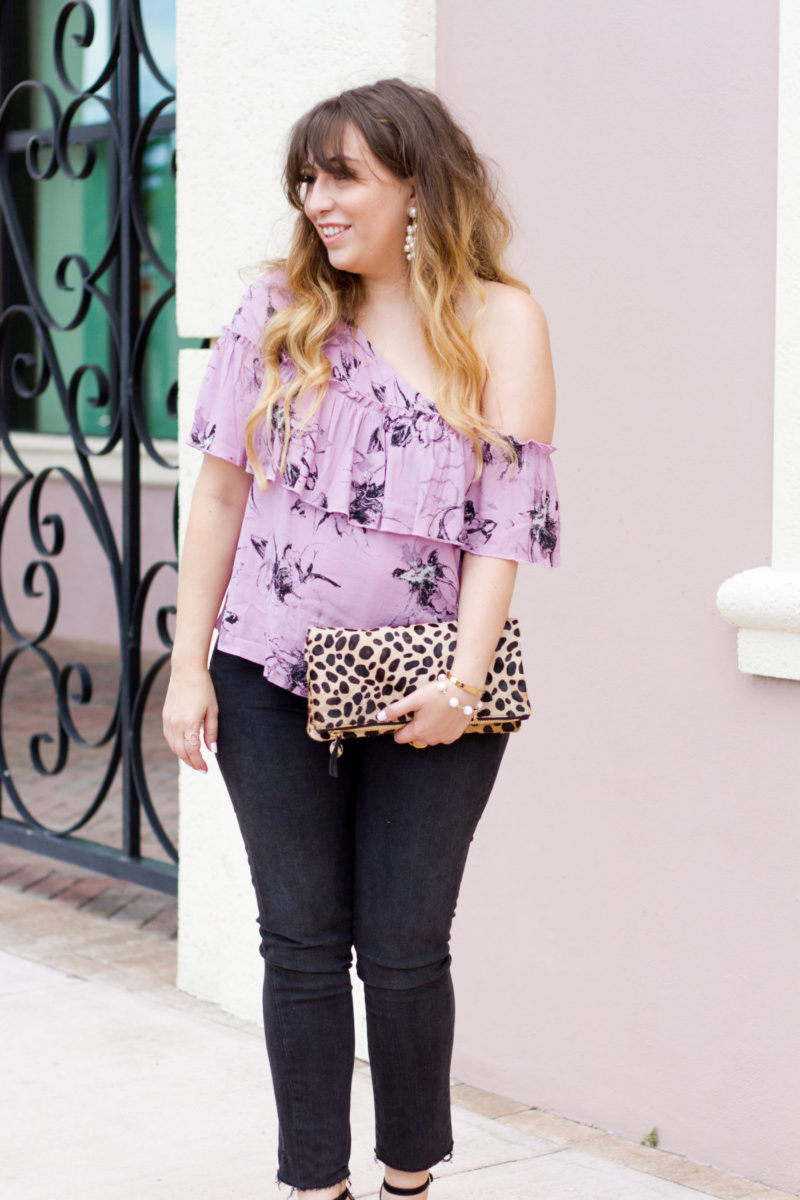 Purple top and jeans