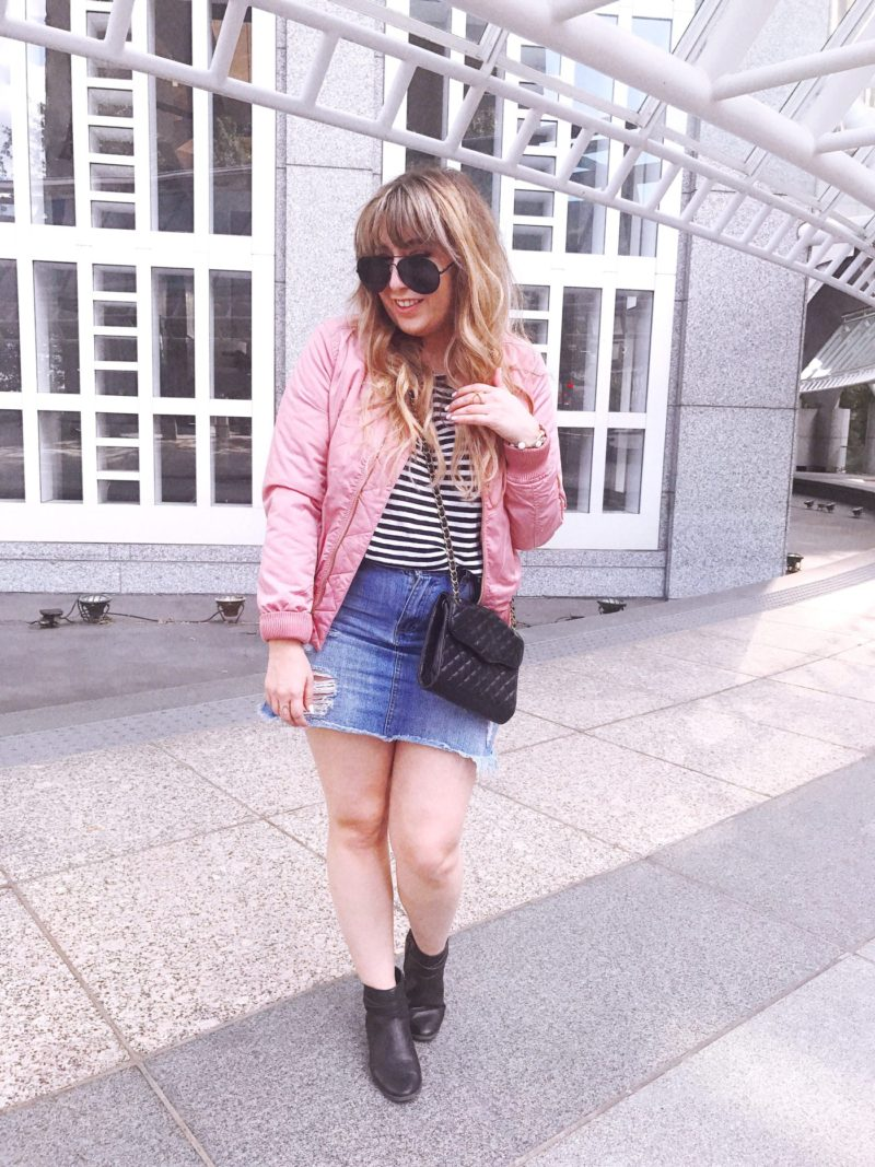 Pink bomber jacket and jean skirt outfit