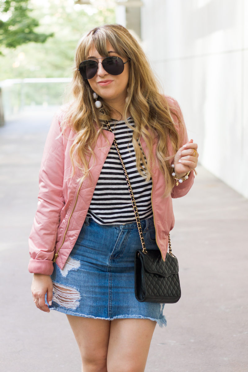 Miami fashion blogger Stephanie Pernas of A Sparkle Factor styles a pink bomber jacket outfit idea for fall.