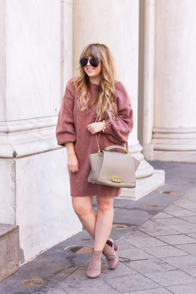 Miami fashion blogger Stephanie Pernas styles a Topshop sweater dress, booties and bag for fall