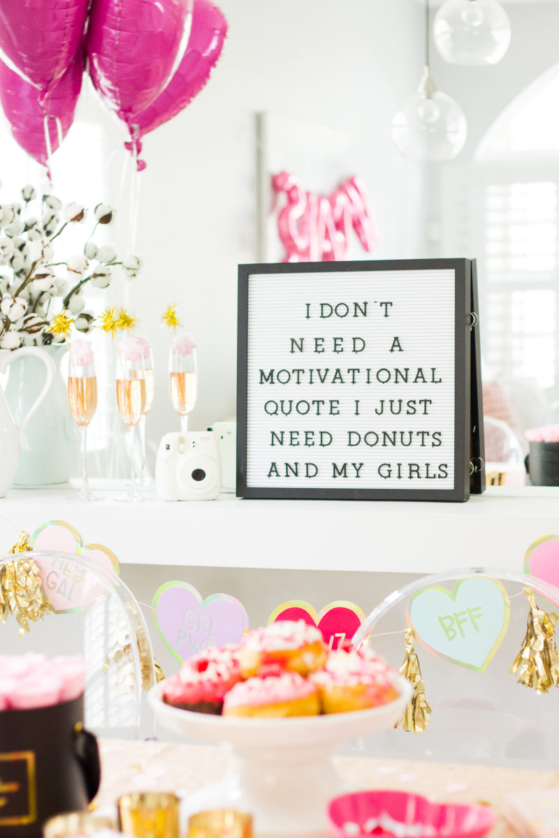 How to throw a Galentine's Day party: cute Galentine's Day party decor. Get a cute letterboard!