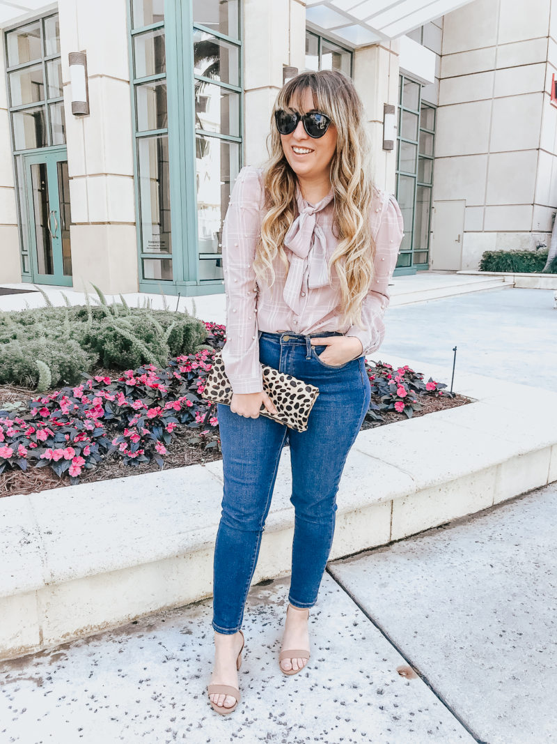 Pearl tie neck blouse and jeans