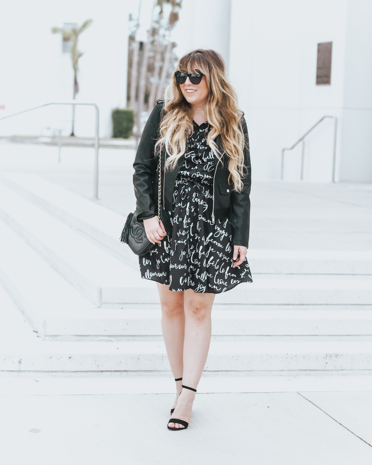 Script shirtdress and leather jacket outfit idea for spring