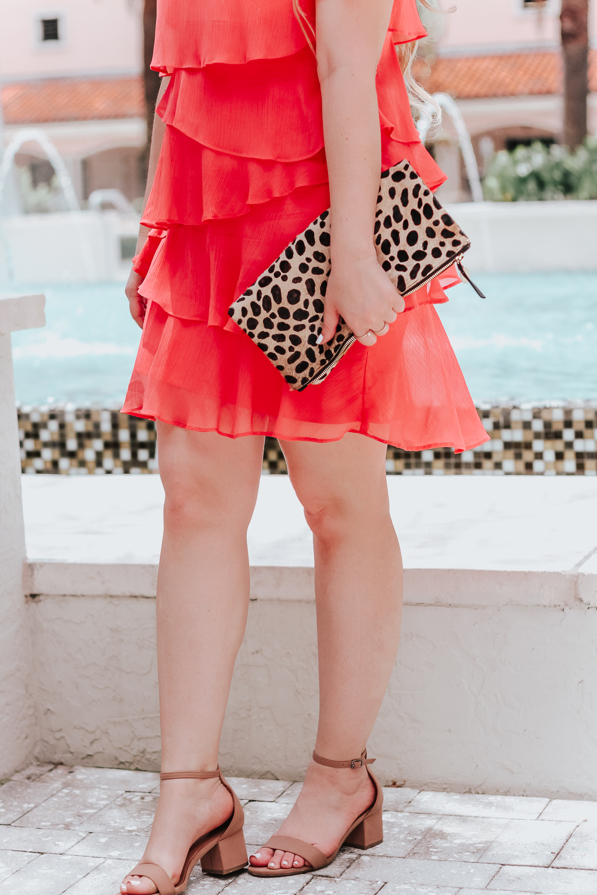 Coral dress and leopard clutch for summer