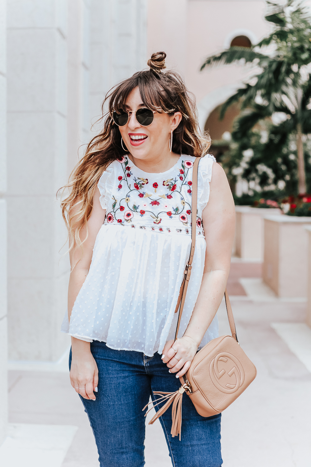 Embroidered babydoll top and jeans outfit idea_