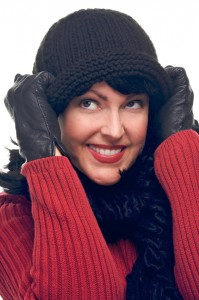 Attractive Woman Holds Her Cap Isolated on a White Background.