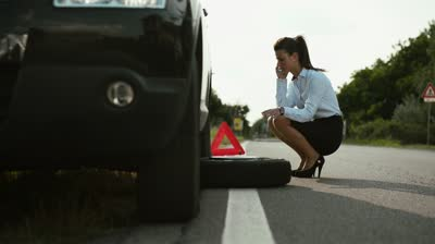 female changing a tyre