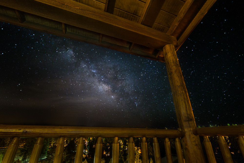 Cabin on the edge of the universe by Darwin. Milky Way from the Balcony. Taken with a Canon 6D and Rokinon 14mm f/2.8