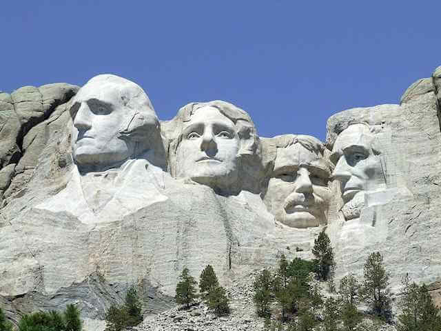 Picture of Mount Rushmore. Carvings of the visage of multiple past U.S. Presidents