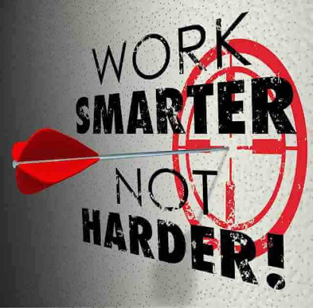 """""""Work smarter, not harder!"""" is written on a board with a bulls-eye and a dart hitting directly in the middle. Working smarter is how the 1% get health care and generally accumulate wealth. The 1% is not to be confused the the 1/10 of 1%"""