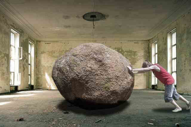 A person is trying to move an impossible large rock. Healthcare obstacles imposed create a demand for certain services to remove them. There are plenty of interests placing difficult obstacles in our path