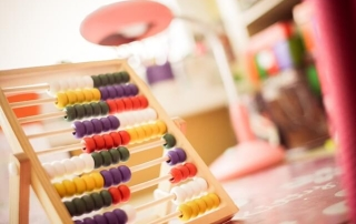 Close-up picture of an abacus. FOCUS. Do healthcare markets have YOU and what YOU want first and foremost on their mind?