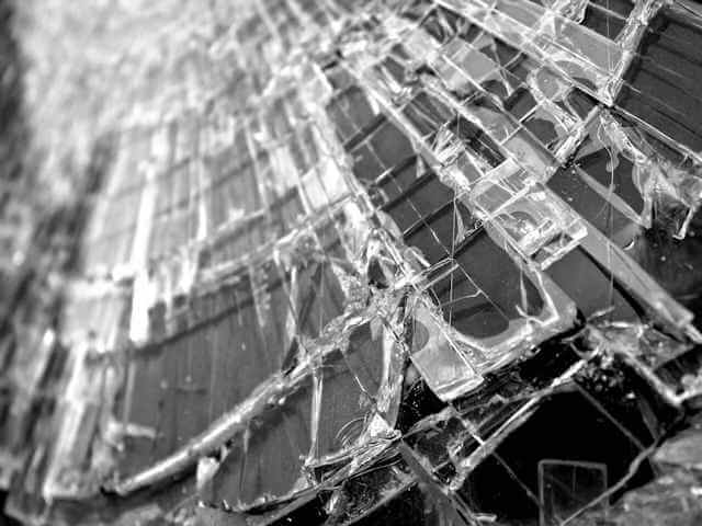 Close-up picture of broken glass pane. Central Planning FAILS again, this time with Obamacare. It cannot be any other way!
