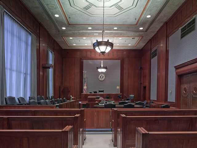 Picture of an empty court room from the entrance. Jury Nullification is the KEY to individual independence and a FREE NATION OF FREE PERSONS!