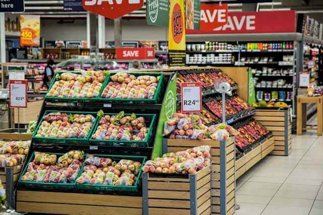 Picture of grocery store signs and food stuff. Right To Shop: The Next Big Thing In Health Care