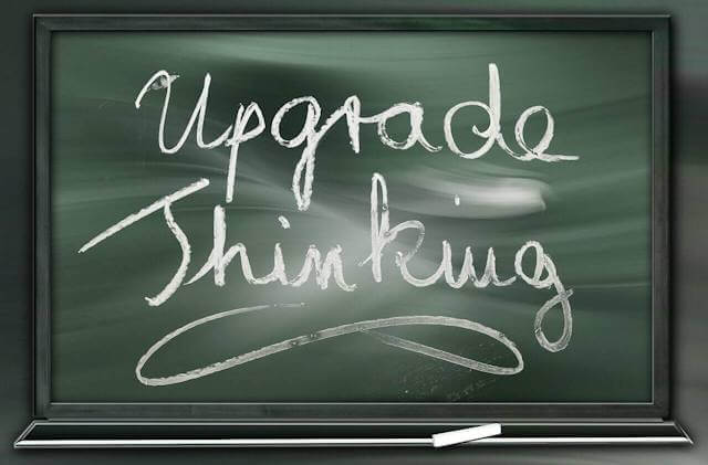 "Cartoon picture of chalkboard with ""Upgrade Thinking"" in cursive written. It is time to upgrade thinking! By so fully pursuing things that exemplify the Law Of Diminishing Returns as well as the Law of Negative Returns, we assure ever more negative results and outcomes in our lives!"