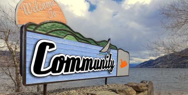"""Picture of large sign reading """"Welcome to Community."""" Decentralizing leads to authentic and viable community, not the opposite."""