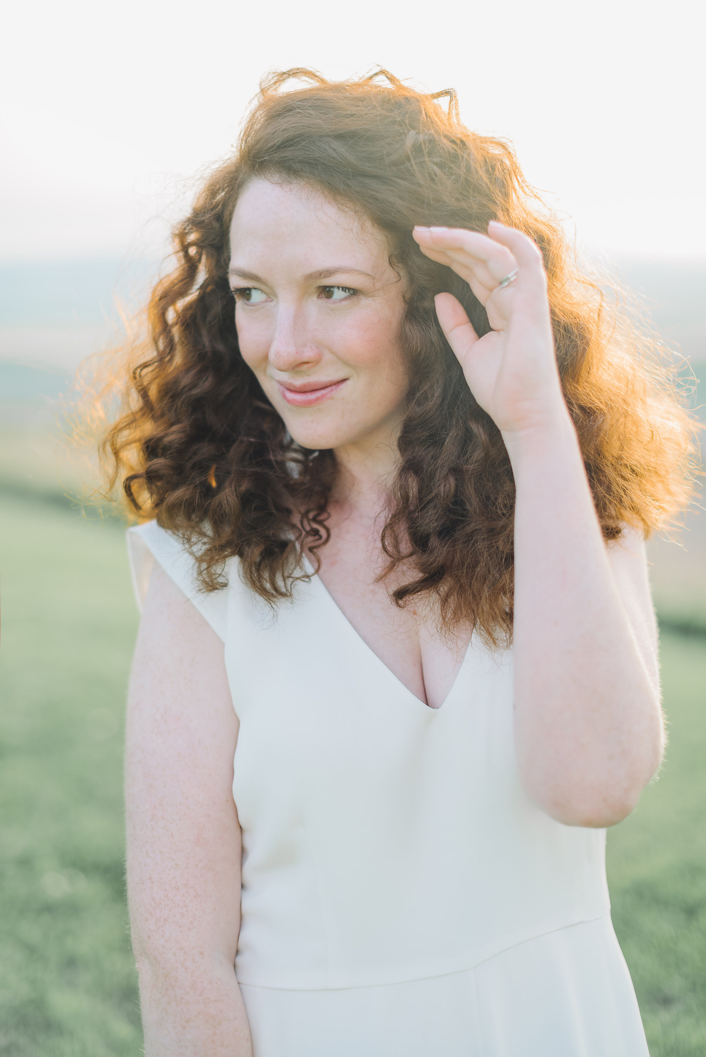 Natural and organic wedding hairstyle for a redhead bride with curls