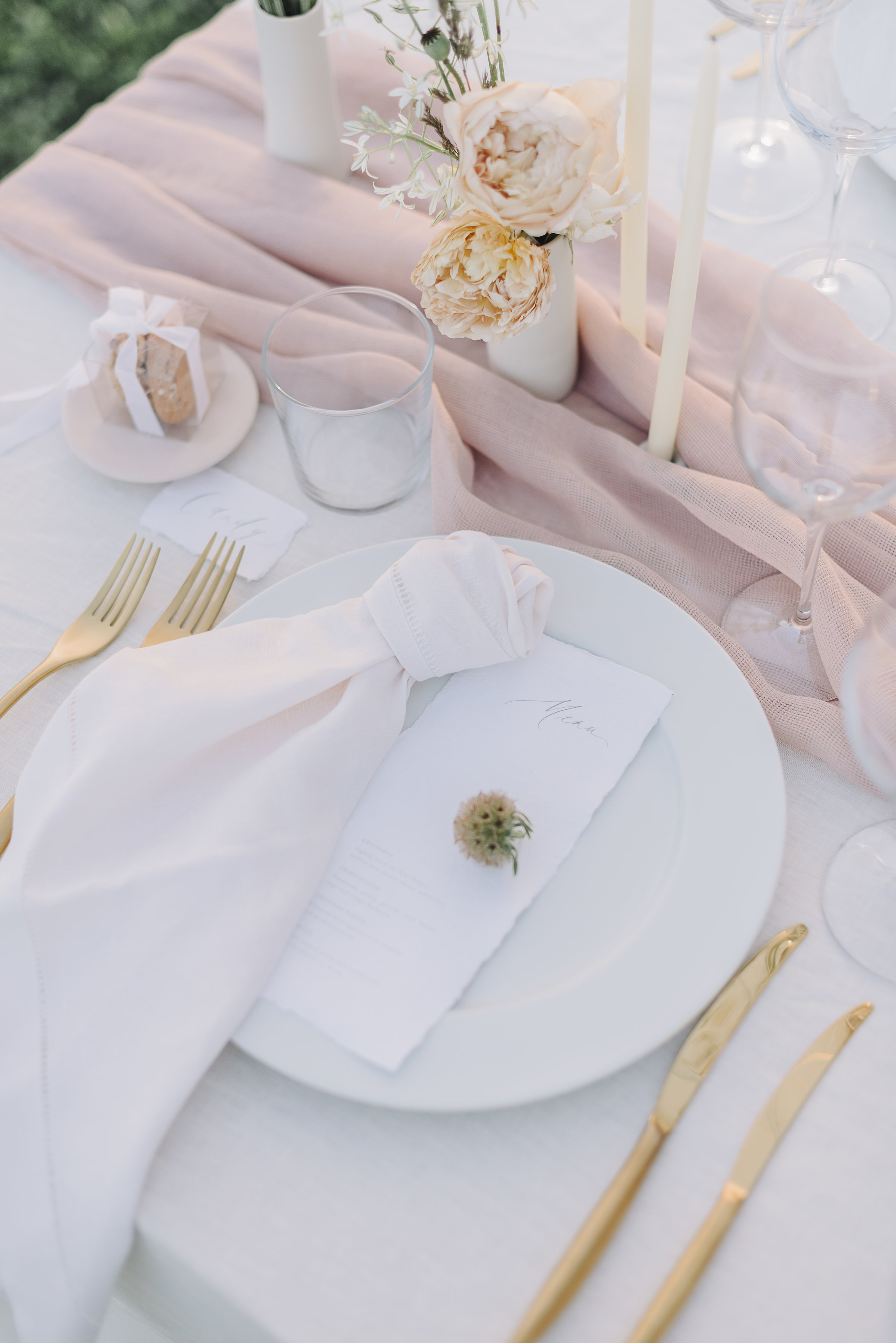 Elegant wedding table set with white, cream and blush accents