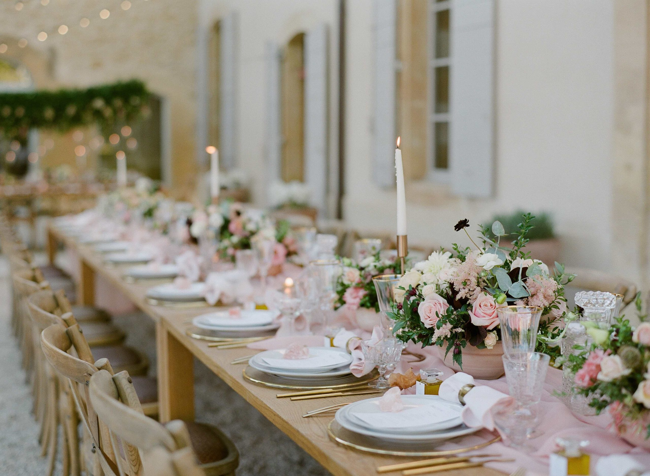 Wedding table decor with long wooden tables, mauve silk runners, pastel flowers with darker accents