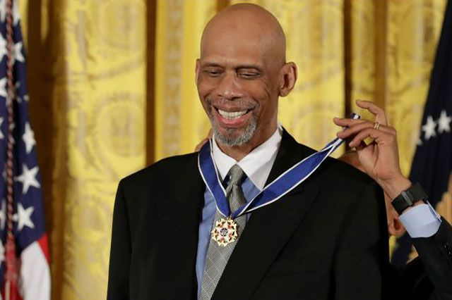 Kareem Abdul-Jabbar receives the Presidential Medal of Freedom from President Barack Obama at White House ceremony Nov. 22, 2016.