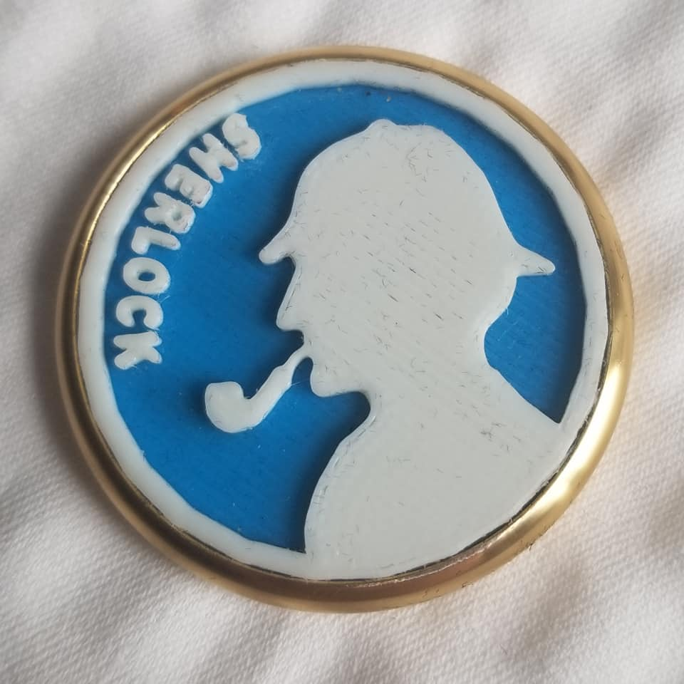 """3D Printed """"Coin"""" Features Sherlock Holmes & Irene Adler"""
