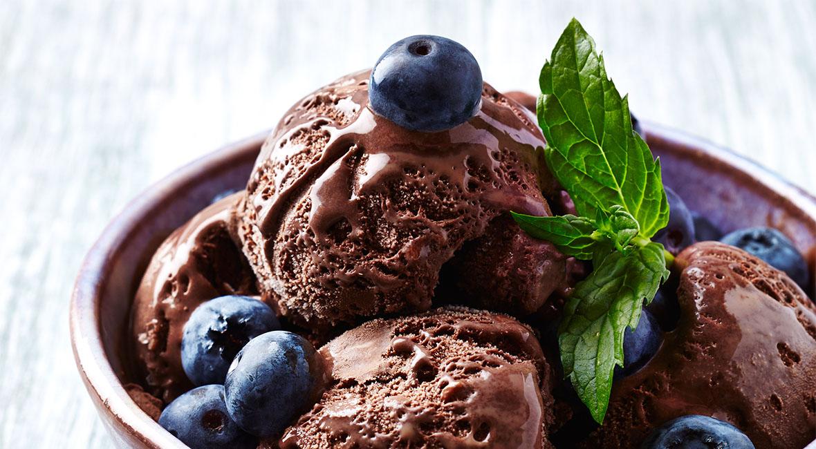 Delicious chocolate ice cream with blackberries