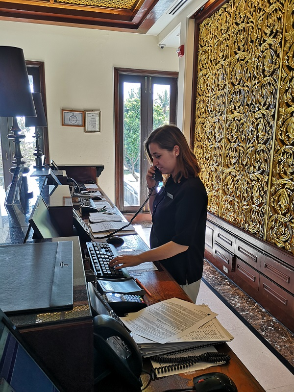 Bianka working on the front desk at a Marriott hotel placement in Thailand