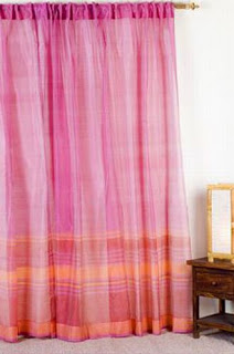 Pink curtain gives a romantic touch to the decor
