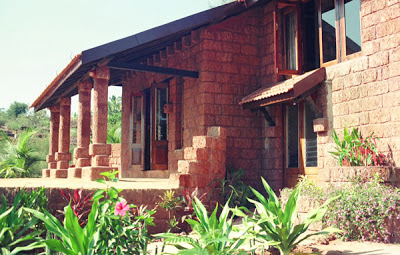 The house is constructed from the local laterite stone