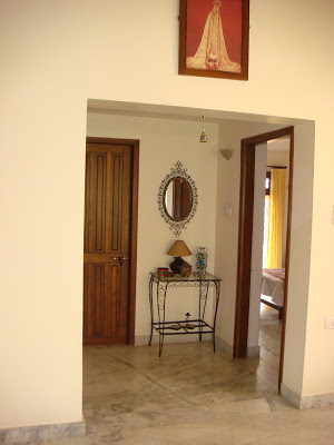 A wrought iron corner in the passage and picture of lady Fatima hangs over the entrance to the bedroom
